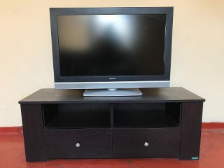 """38"""" Flat screen TV with large TV stand with drawers and shelves"""